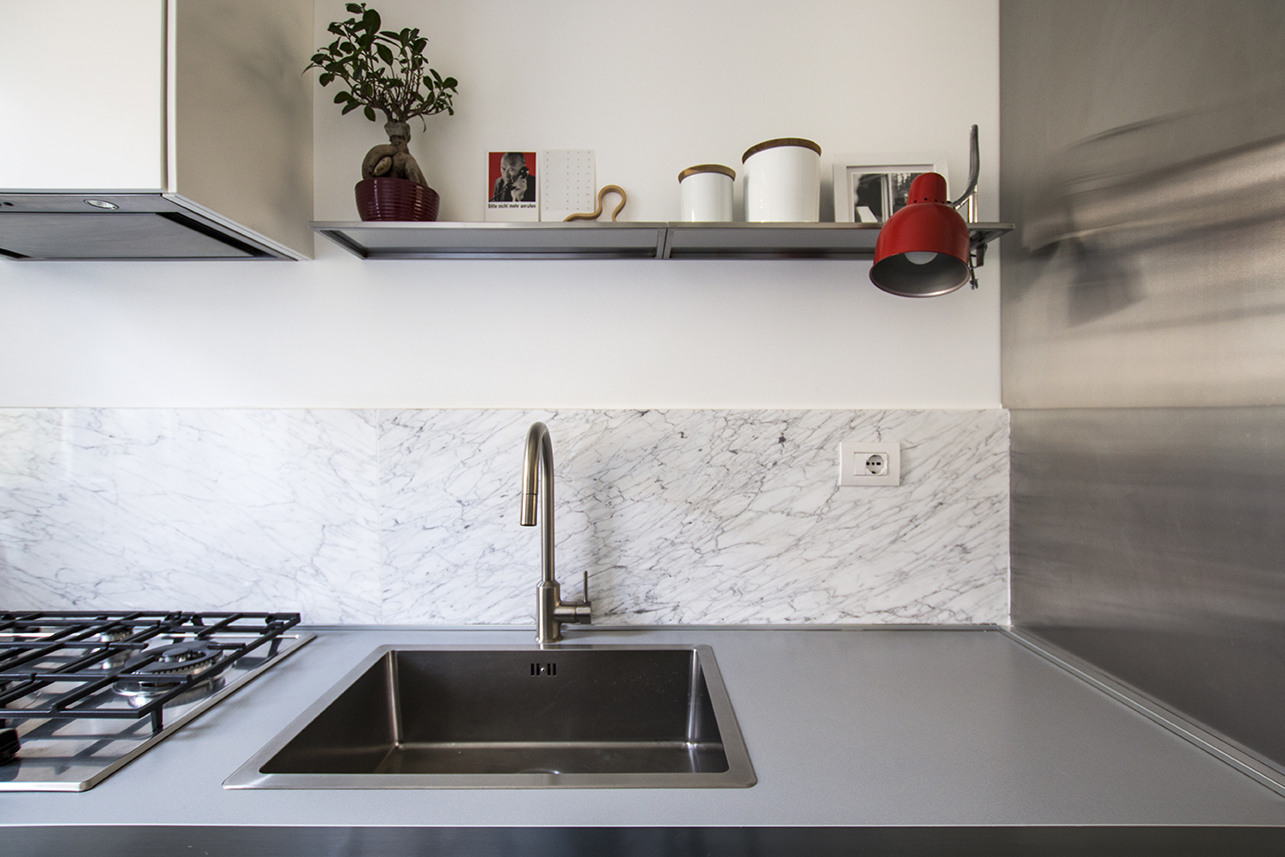 Kickoffice interiors designer architect casaa kitchen faucet sink carrara marble shelf stainlesssteel bonsai