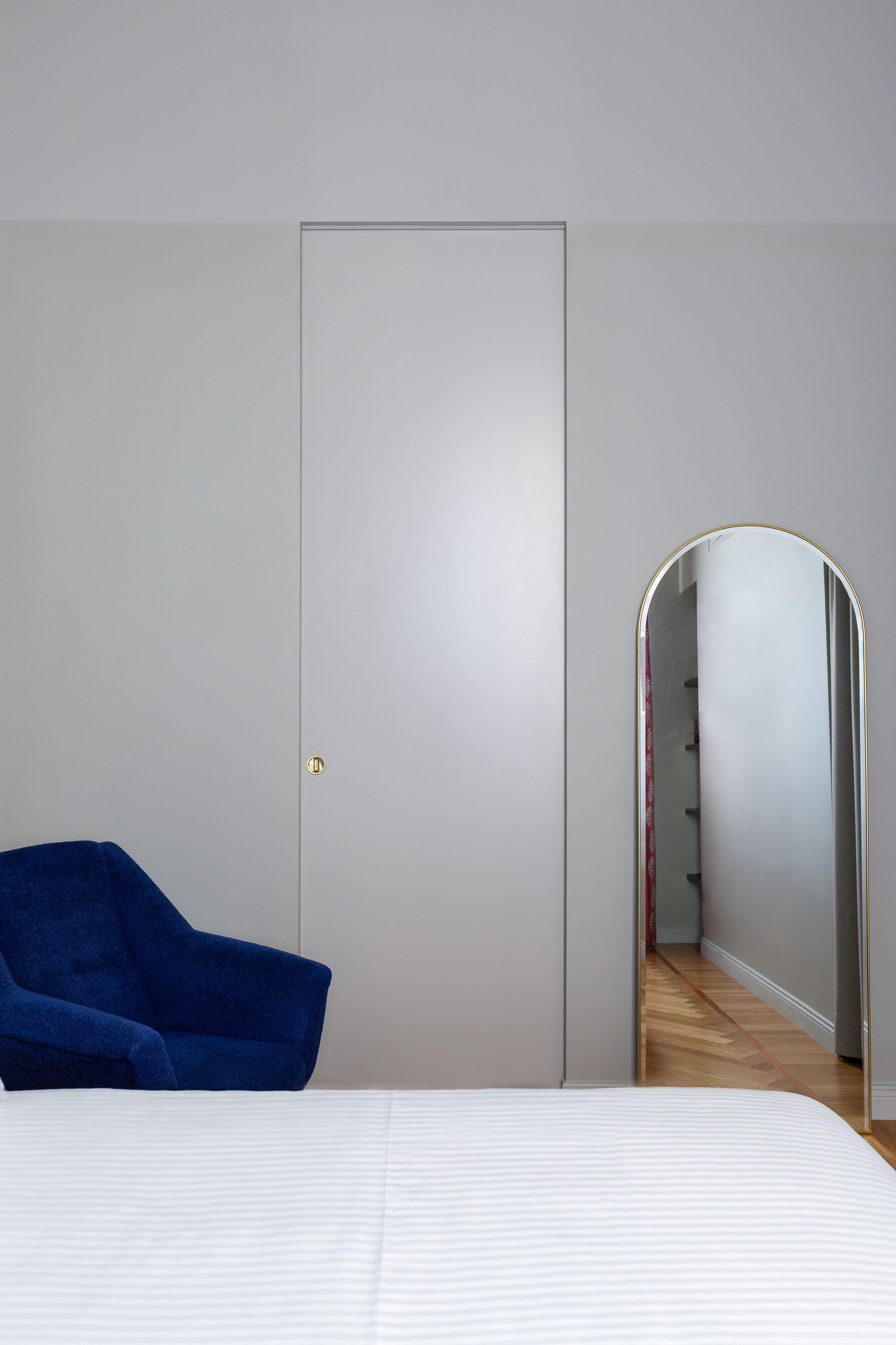 kickoffice broggi apartments bedroom grey surface blue