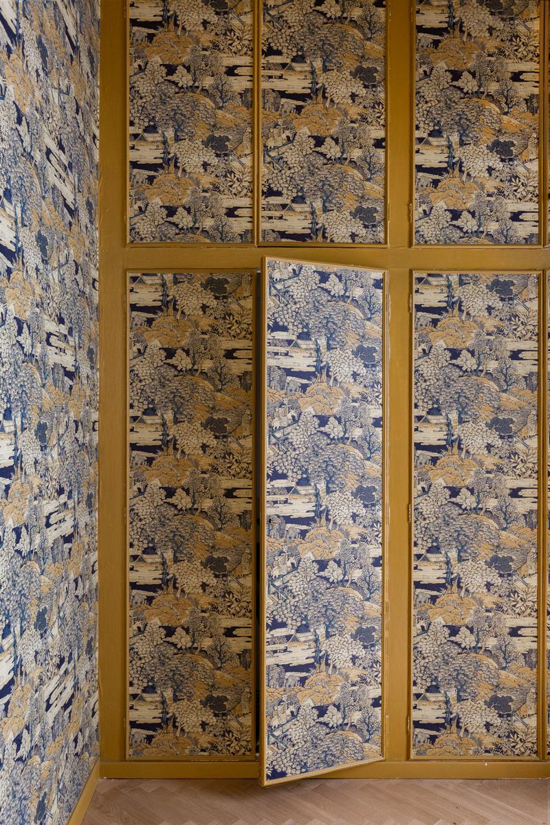 kickoffice settembrini rooms entrance arch wallpaper wardrobe